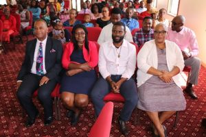Hon. Eric Evelyn, Minister of Information (extreme left); Ms. Judith Dasent, Acting Director at the Department of Information and staff worshipping at the New Testament Church of God at Bath Village on January 27, 2019 at the start of the department's awareness week of activities