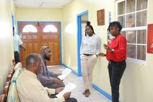 Former NTv newscasters (sitting l-r) Hon. Eric Evelyn and Mr. Huey Sargeant discussing the news package before presenting with Mrs. Donace Wilkinson-Caines, Deputy Director of the Department of Information/anchor and Ms. Fredicia Liburd Assistant News Editor/anchor at the department on January 28, 2019