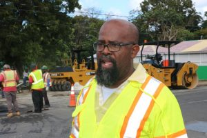 Mr. Daniel Williams, Supervisor of Roads at the Public Works Department on Nevis directing road works at Bath Village on February 13, 2019