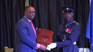 Hon. Mark Brantley, Premier of Nevis presenting the Top Constable 2018 Award and plaque to Constable Carl Gordon of the Criminal Investigation Department at the Royal St. Christopher and Nevis Police Force (Nevis Division) Constable's Awards Ceremony and Dinner, hosted by the Strategic Planning Group on February 23, 2019, at the Occasions Entertainment Arcade at Pinney's Estate