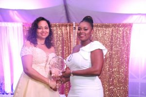 First Lady Mrs. Sharon Brantley presents plaque to graduate Ms. Lisa Lee at the First Congratulatory Reception for University Graduates hosted by Hon. Mark Brantley, Premier of Nevis and Mrs. Brantley at Government House at Belle Vue on February 09, 2019
