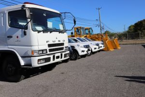 Seven vehicles at the Nevis Disaster Management Department's parking lot at Long Point, part of a multi-million dollar gift from the Government and people of Japan to the Nevis Island Administration