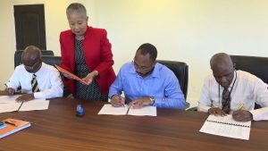 (L-r) Mr. Wakely Daniel Permanent Secretary in the Premier's Ministry, Mrs. Hélène Anne Lewis, Legal Advisor to the NIA; Mr. Jonel Powell, Managing Director and Legal Counsel of B&L Worldwide Ltd.; and Mr. Oral Brandy, Manager of the Nevis Air and Sea Port Authority signing the Concession Agreement Regarding the Development of Vance W. Amory International Airport, by and between the Nevis Island Administration, Nevis Air and Sea Port Authority and B&L Worldwide Ltd. On February 06, 2019 in Cabinet Room at Pinney's Estate