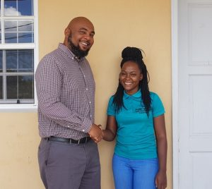Mr. Huey Sargeant, Marketing Chairman of the Culturama Committee; Ms. Verneen Williams, winner of the Culturama Secretariat's 2019 Nevis Culturama Festival Slogan Competition