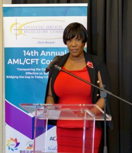 Photo caption: MS. Heidi-Lynn Sutton, Regulator, Financial Services Regulatory Commission – Nevis Branch, gives welcoming remarks during the Opening Ceremony of the 14th Annual AML/CFT Conference on March 11, 2019 at the Four Seasons Resort Nevis