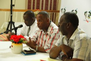 Hon. Eric Evelyn, Minister of Culture (middle) flanked by Mr. Keith Glasgow, Permanent Secretary in the Ministry of Culture and Mr. Abonati Liburd, Executive Director of the Culturama Secretariat while addressing participants in Charlestown at the last of three consultations held by the Ministry of Culture and the Culturama Secretariat ahead of Culturama