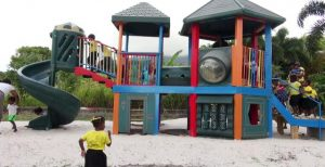 Students of Naomi's Nursery and Pre School in Garricks Pasture, Jessups Village enjoying a playground donated by the Four Seasons Resort, Nevis