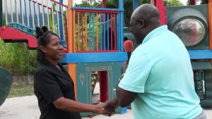 Mr. Mac Kee France, Director of Guest Experiences at the Four Seasons Resort, Nevis, presenting a playground to Mrs. Naomi Douglas, Supervisor/Proprietor of Naomi's Nursery and Pre School, in Garrick's Pasture, Jessups Village recently