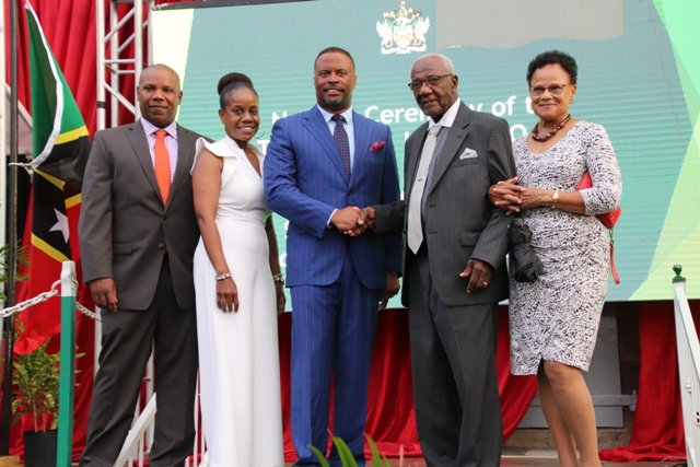 Mr. Theodore Hobson Q.C. and his family with Hon. Mark Brantley, Premier of Nevis standing in front of the newly named Theodore L. Hobson Court Building in Charlestown on April 28, 2019