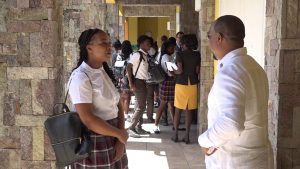 Mr. Samuel Berridge, Senior Foreign Service Officer in the Ministry of Foreign Affairs, speaks with a student of the Nevis Sixth Form College at the Nevis Performing Arts Centre, during Diplomatic Week 2019