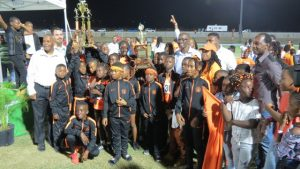 Athletes and staff of the Charlestown Primary School, champions of Zone A in the 27th annual Gulf Insurance Inter-Primary Schools Championship with their trophy presented by Mr. Henry Francis Human Resource Manager of the Gulf Insurance Ltd. in Trinidad, at the Nevis Athletic Stadium at Low Ground on April 03, 2019. Also present are Hon. Eric Evelyn, Minister of Youth and Sports on Nevis and Hon. Troy Liburd, Junior Minister of Education and Mr. Kevin Barrett, Permanent Secretary in the Ministry of Education and Principal Ms. Latoya Jeffers