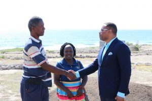 Mr. Keithley Amory, Coordinator of the Nevis Historical Conservation Society's New River Coconut Walk Restoration Project, and Ms. Pauline Ngunjiri, Executive Director of the Nevis Historical and Conservation Society, welcomes Hon. Mark Brantley, Premier of Nevis, to Coconut Walk on April 23, 2019