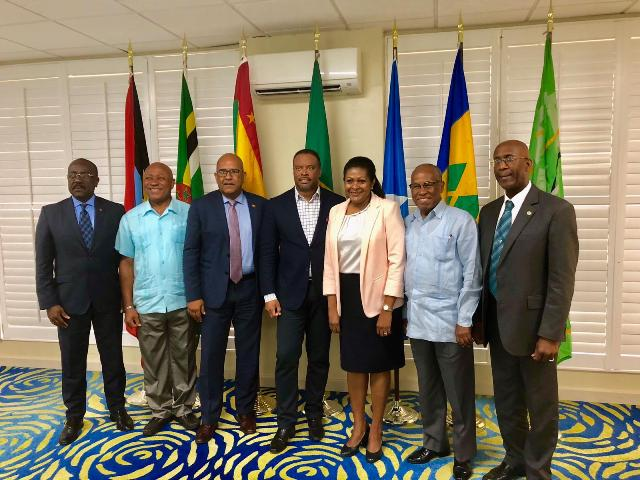 Hon. Mark Brantley, St. Kitts and Nevis Minister of Foreign Affairs and Aviation (fourth from left) with counterparts from the region for the Fifth Meeting of the Organisation of Eastern Caribbean States Council of Foreign Affairs, and the Twenty-Second Meeting of the Council of Foreign and Community Relations from May 12 to 14 at the Radisson Resort in Grand Anse, Grenada