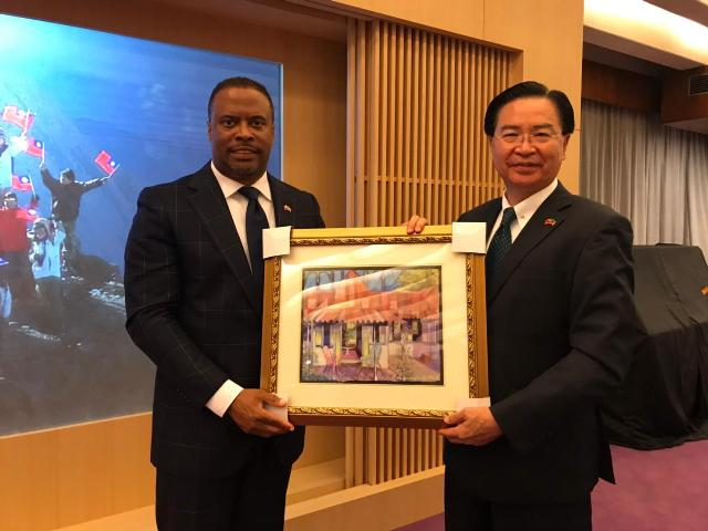 (L-r) Hon. Mark Brantley Minister of Foreign Affairs and Aviation, and Premier of Nevis presents a gift to his Taiwanese counterpart, His Excellency Dr. Jaushieh Joseph Wu at the Ministry of Foreign Affairs in the Republic of China (Taiwan) on March 09, 2019