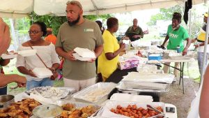 Mr. Huey Sargeant, Permanent Secretary in the Ministry of Agriculture, among patrons at the Jessups Seafood Fiesta 2019 at Jessups Village on May 06, 2019, an activity on the Ministry of Tourism's Exposition Nevis 2019 calendar