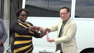 Mr. Yuji Takeuchie General Manager of Futurebud International Co. Ltd. hands over the keys for a mobile medical vehicle on behalf of the government and people of Japan to Hon. Hazel Brandy Williams, Junior Minister of Health on Nevis at the Nevis Disaster Management Department grounds on May 29, 2019