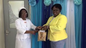 (L-r) Mrs. Aldris Pemberton Dias, Matron at the Alexandra Hospital, one of 116 nurses receiving a token of appreciation from Hon. Hazel Brandy-Williams, Junior Minister of Health on Nevis, on May 10, 2019