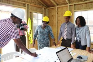 Mr. Billy Claxton, Project Manager of the Alexandra Hospital Expansion Project, shows layout of the project to (l-r) Hon. Hazel-Brandy Williams, Junior Minister of Health; Mr. Gary Pemberton, Hospital Administration; and Mrs. Shelisa Martin-Clarke, Acting Permanent Secretary in the Ministry of Health; during a walk-through of the project on Thursday, May 23, 2019