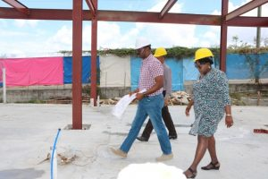 Hon. Hazel Brandy-Williams, Junior Minister of Health on Nevis walks through ongoing work for the Alexandra Hospital Expansion Project on Thursday, May 23, 2019, flanked by Mr. Billy Claxton, Project Manager, and Mr. Gary Pemberton, Hospital Administrator