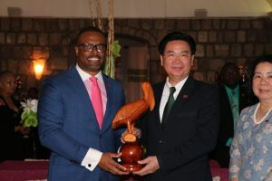 (L-r) Hon. Mark Brantley, Minister of Foreign Affairs and Aviation, and Premier of Nevis presents a gift to Dr. the Hon. Jaushieh Wu, Foreign Affairs Minister of the Republic of China (Taiwan) during his inaugural visit to the Federation, at a reception at the Montpelier Plantation Inn on May 28, 2019 while Mrs Wu looks on