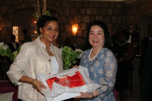 Mrs. Sharon Brantley, wife of Hon Mark Brantley, Minister of Foreign Affairs and Aviation, and Premier of Nevis presents a gift to Mrs. Ru-Yuh Wu, wife of Dr. the Hon. Jaushieh Wu, Foreign Affairs Minister of the Republic of China (Taiwan), at a reception at the Montpelier Plantation Inn on May 28, 2019