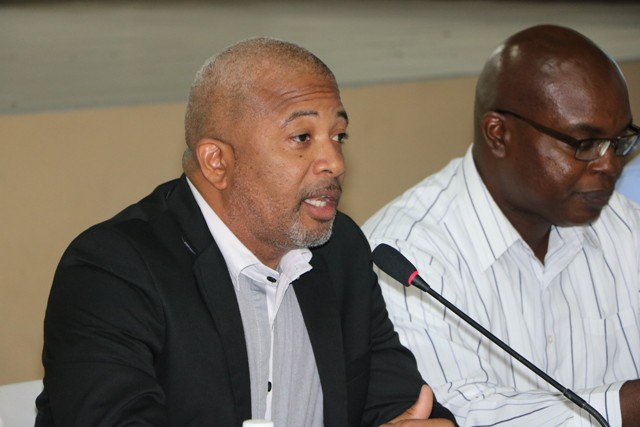 Hon. Spencer Brand, Minister of Communication and Works on Nevis and Dr. Ernie Stapleton, Permanent Secretary in the Ministry of Communications and Works, at a town hall meeting at the Cotton Ground Community Centre hosted by the Ministry of Communications and Works on May 30, 2019 addressing residents on Phase 1 of the Island Main Road Rehabilitation and Safety Improvement Project