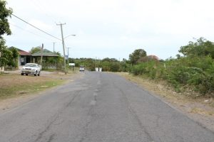A section of the road to be rehabilitated in Phase 1 of the Island Main Road Rehabilitation and Safety Improvement Project from Cotton Ground to Cliff Dwellers