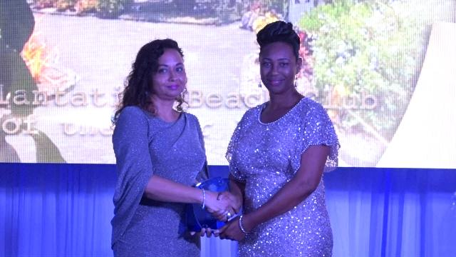 Mrs. Pamela Martin, Resort Manager of the Nisbet Plantation Beach Club, receives the award for Hotel of the Year 2019 on behalf of the resort from First Lady Mrs. Sharon Brantley at the Ministry of Tourism' s Nevis Tourism Industry Awards ceremony on May 25, 2019, on the grounds of Government House at Bath Plain