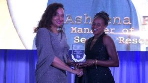 Ms. Asheena Farrell of the Four Seasons Resort, Nevis receives the award for Hotel Manager of the Year 2019 from First Lady Mrs. Sharon Brantley at the Ministry of Tourism' s Nevis Tourism Industry Awards ceremony on May 25, 2019, on the grounds of Government House at Bath Plain