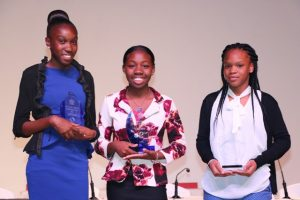 (L-r) Second and first place winners respectively from the Charlestown Secondary School Ms. Donella Thompson and Ms. Brianne Chapman; and Ms. Sharinque Reid third place winner from the Nevis International Secondary School, the top winners of The Bank of Nevis Ltd. Tourism Youth Congress hosted by the Ministry of Tourism at the Nevis Performing Arts Centre on May 21, 2019