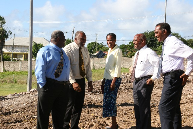 "Past members of the Nevis Island Administration Cabinet headed by (extreme right) Hon. Vance Amory sharing a light moment on a field trip in February 2006 at then Grove Park in Charlestown. (L-r) Hon. Malcolm Guishard, Hon. Livingston ""Kitty"" Herbert, Hon. Jean Harris and Hon. Laughton Brandy (file photo)"