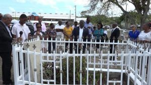 Hon Alexis Jeffers, Deputy Premier of Nevis singing a hymn at a Memorial Service for Hon. Malcolm Guishard of blessed memory at the Bath Cemetery on June 11, 2019