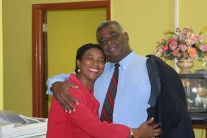 Hon. Malcolm Guishard Minister of Information in the Nevis Island Administration at the Department of Information greets staff member Mrs. Joan Stapleton-Pemberton at one of his many visits in February 2005 (file photo)