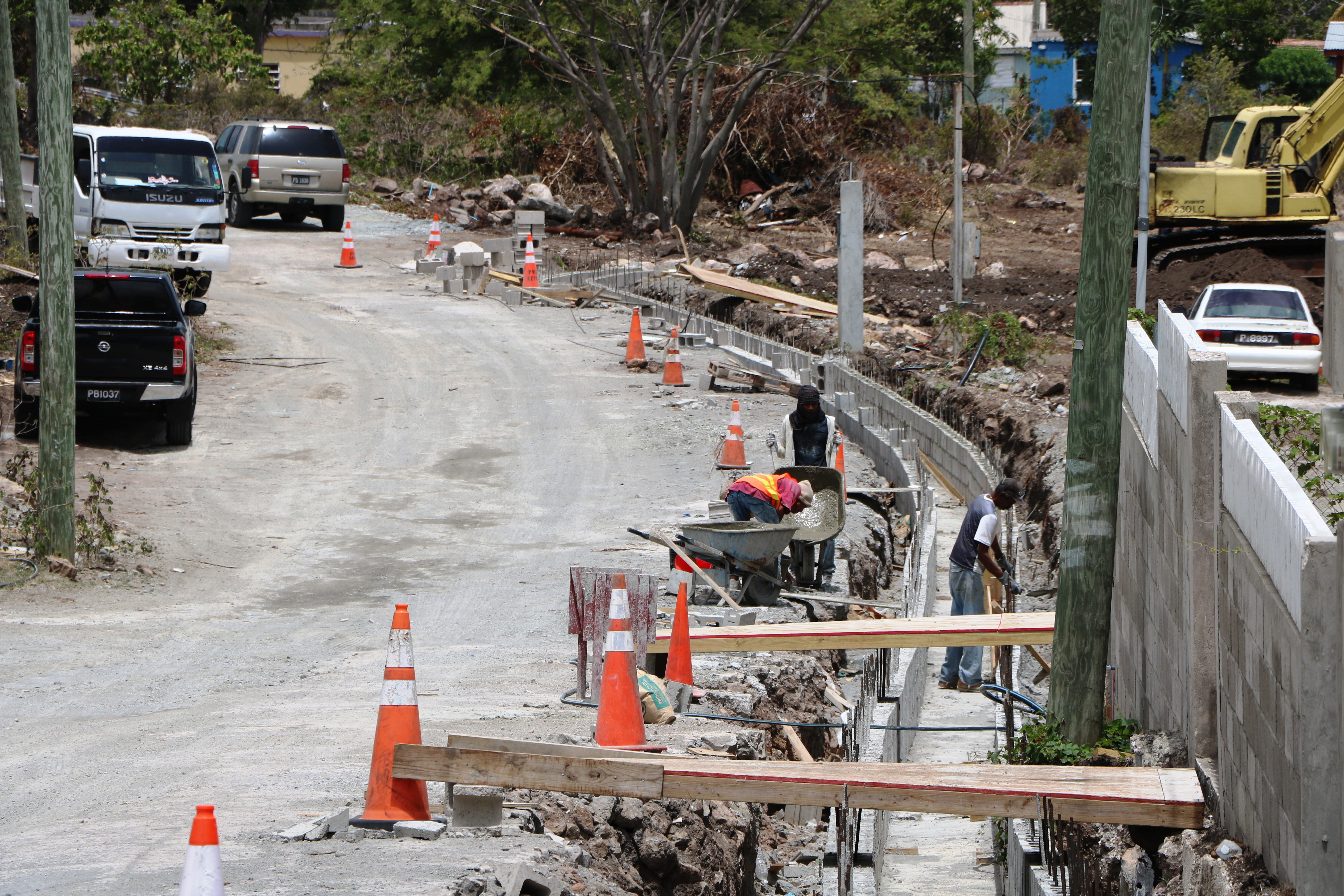 Workers from the Public Works Department working on the construction of U-drains in the Craddock Road Rehabilitation Project on July 23, 2019
