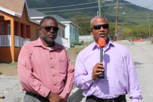 Hon. Spencer Brand, Minister of Communication and Works (left), accompanied by Mr. Denzil Stanley, Assistant Permanent Secretary in the Ministry of Communication and Works, speaking to the Department of Information during a sight visit to the Craddock Road Rehabilitation Project on July 24, 2019