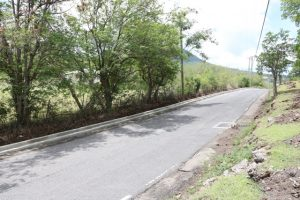 A section of the 80 meters of curb and slipper drain poured at Cliff Dwellers in the Nevis Island Administration's EC$6.7million Island Main Road Rehabilitation and Safety Improvement Project
