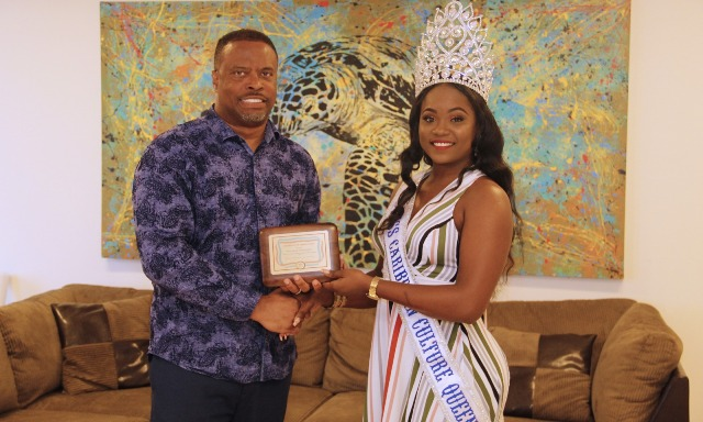 Hon. Mark Brantley, Premier of Nevis receives a token of appreciation from Ms. Shellisa Nanton of St. Vincent and the Grenadines, the reigning Flow Miss Caribbean Culture Queen at his Pinney's office on August 02, 2019