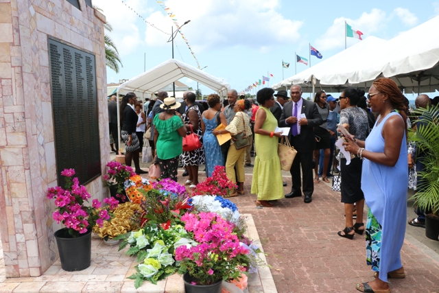 The MV Christena Disaster Memorial on Hunkins Drive adorned with colourful wreaths at the end of the 49th Anniversary Memorial Service for the MV Christena Disaster on August 01, 2019, a tragedy in which hundreds of persons perished and less than 100 survived