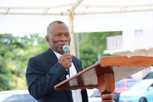 Pastor Arthur Freeman delivering a sermonette at the 49th Anniversary Memorial Service for the MV Christena Disaster on Samuel Hunkins Drive on August 01, 2019