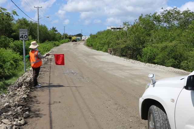 A flag lady with Surrey Paving & Aggregate Co. Ltd at work on the Island Main Road Rehabilitation and Safety Improvement Project on August 13, 2019
