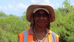 Ms. Loretta Greene Phillip a flag lady with Surrey Paving &Aggregate Co. Ltd, contractors for Phase 1 of the Nevis Island Administration's EC$6.7 million Island Main Road Rehabilitation and Safety Improvement Project from Cotton Ground to Cliff Dwellers at work on the project on August 13, 2019