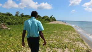 Mr. Lemuel Pemberton, Deputy Director of the Marine Resources Department on Nevis at Cades Bay Beach on August 13, 2019, in the area where a nesting hawksbill was taken by poachers days before