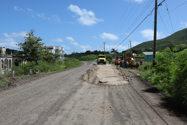 Base material being place on the road on August 13, 2019 in Phase 1 of the Island Main Road Rehabilitation and Safety Improvement Project from Cotton Ground to Cliff Dwellers