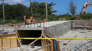 Ongoing construction work on the first box culvert on August 13, 2019, in Phase 1 of the Island Main Road Rehabilitation and Safety Improvement Project from Cotton Ground to Cliff Dwellers