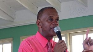 Hon. Eric Evelyn, Minister of Youth and Area representative for the St. George's Parish, addressing Gingerland Secondary School students during assembly on September 13, 2019