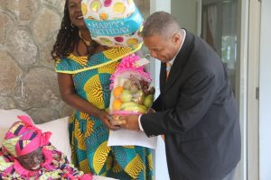 "Hon. Eric Evelyn, Minister of Social Development with responsibility for seniors on Nevis, celebrating with Ms. Celian ""Martin"" Powell on her 106th birthday at the Flamboyant Nursing Home on January 19, 2018 (file photo)"