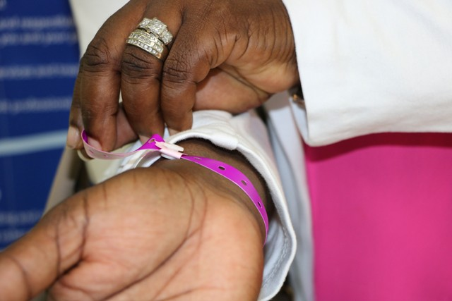 Hon. Hazel Brandy Williams Junior Minister of Health in the Nevis Island Administration demonstrates the use of the new identification wrist bands issued to persons admitted to the Alexandra Hospital during her visit to the health facility on October 11, 2019