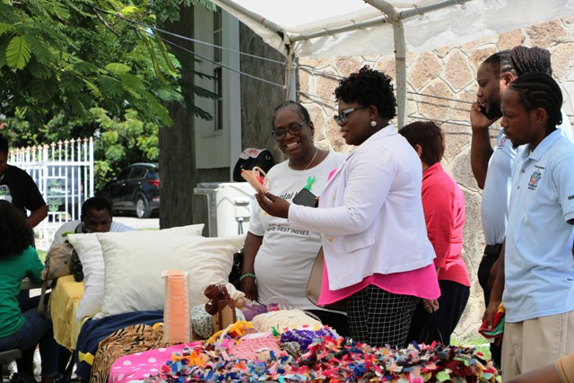 Hon. Hazel Brandy-Williams viewing exhibits at an exhibition staged by the Mental Health Unit in the Ministry of Health on October 11, 2019, at the Nevis Island Administration grounds in Charlestown, with Nurse Joyah Walters, Nurse Manager at the Mental Health Unit on Nevis and other staff members looking on