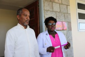 Hon. Hazel Brandy Williams, Junior Minister of Health with Mr. Gary Pemberton, Hospital Administrator showing off one of the new identification wrist bands issued to anyone admitted to the Alexandra Hospital during her visit to the health facility on October 11, 2019