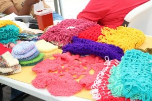Knitted items done by clients of the Mental Health Unit on display at an exhibition staged by the unit on October 11, 2019, at the Nevis Island Administration grounds in Charlestown, in observance of World Mental Health Day 2019